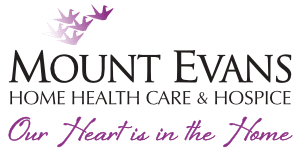 "The Mount Evans logo with stylized purple birds flying overhead and the tag-line ""Our Heart is in the Home""."