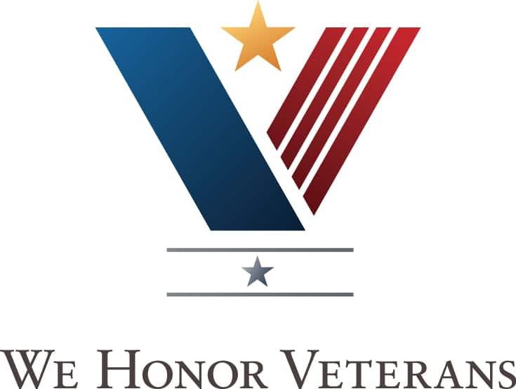 "Text logo stating ""We Honor Veterans"""
