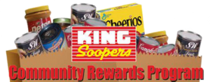 Text graphic showing King Soopers Community Rewards Program with groceries in the background