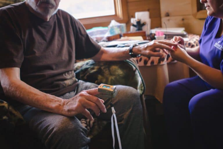 Hospice patient having his O2 reading done with a pulse oximeter