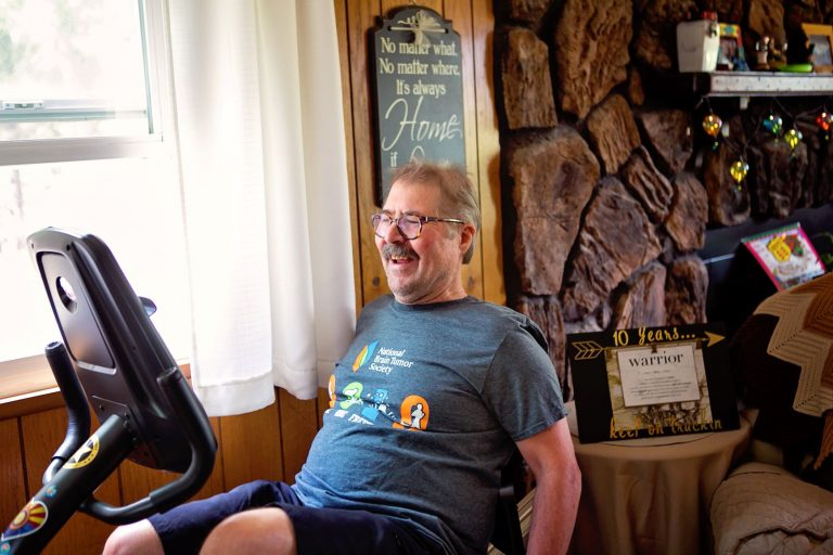 Don Sypert is a 10 year survivor of brain cancer shown here on an exercise cycle in his living room